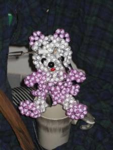 A bedazzled bear impaled with Picasso-inspired fondue forks